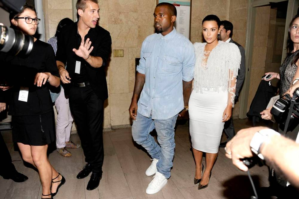 Kim and Kanye in the midst of paprazzi